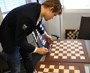 Chessboard Signed by World Champion Magnus Carlsen